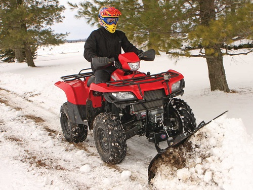 Pushing Some Snow With An ATV