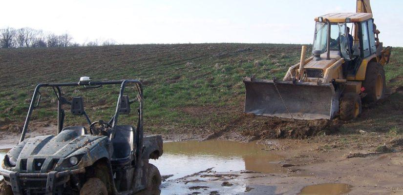 ATV Stuck In Mud With Backhoe Loader